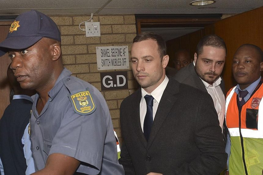 Oscar Pistorius leaves Pretoria's North Gauteng High Court on March 4, 2014, on the second day of South African amputee Olympian sprinter Pistorius' murder trial, accused of murdering his girlfriend Reeva Steenkamp.A key witness who testified t