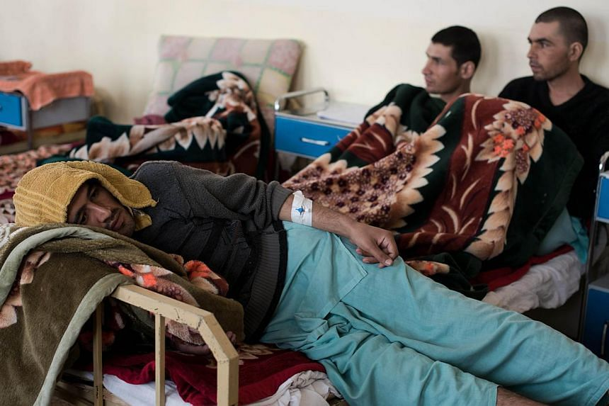 This picture taken on February 23, 2014, shows patients relaxing in their dormitory, at the Jangalak hospital in Kabul. The Jangalak hospital is a government runned hospital with a capacity of 300 beds, that receives drug users for a 45 days treatmen