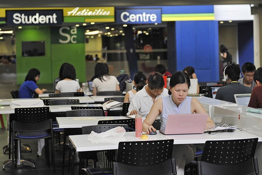 Students offered a place at Nanyang Technological University (NTU) from this year onwards will receive their offer letters electronically instead of in paper form - a first for a Singapore university. -- ST PHOTO: MATTHIAS HO