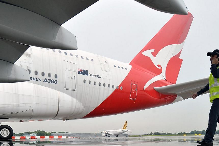 The Australian government insisted on March 4, 2014, there would be no blank cheques to bail out national carrier Qantas, which admitted a plan to repeal legislation restricting foreign ownership was destined to fail. -- ST FILE PHOTO:ALPHONSUS