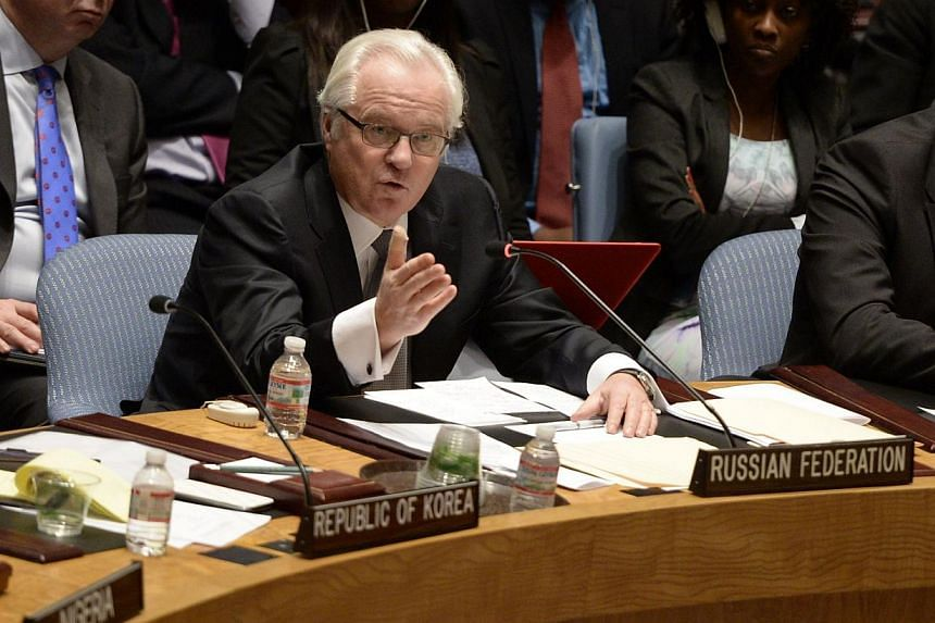Vitaly Churkin, Permanent Representative of the Russian Federation to the United Nations speaks during a Security Council meeting at the United Nations in New York on March 3, 2014. -- PHOTO: AFP