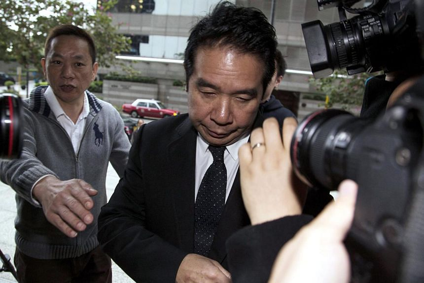 Businessman Carson Yeung arrives at a district court in Hong Kong on Feb 28, 2014. Yeung may be stripped of his shares in the club following his guilty verdict for money laundering, a government prosecutor said on Tuesday. -- FILE PHOTO: REUTERS