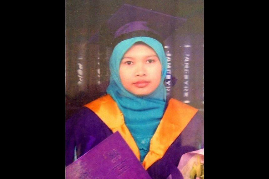 Malaysian Nurul Rohana Ishak, who was arrested for illegally entering the Ministry of Foreign Affairs headquarters on Jan 20, 2014. The family of the Malaysian teacher who is facing charges after illegally entering Singapore last month attended