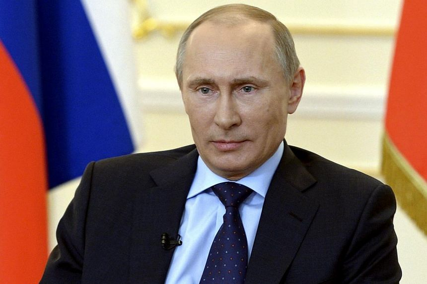 Russian President Vladimir Putin takes part in a news conference at the Novo-Ogaryovo state residence outside Moscow on March 4, 2014.Putin said on Tuesday that Russia saw no need to use military force in the Crimea region of Ukraine for now, i
