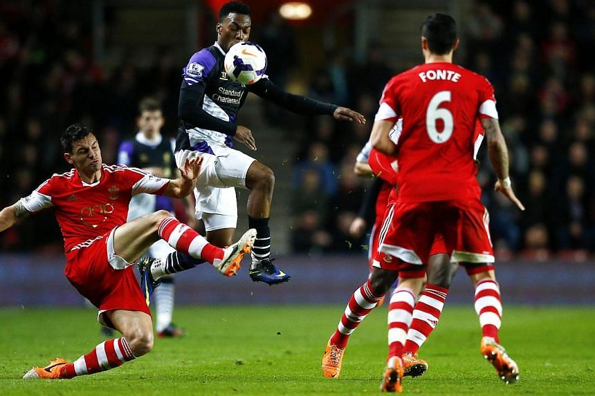 Daniel Sturridge of Liverpool evades a challenge from Southampton's Morgan Schneiderlin during their English Premier League soccer match at St Mary's Stadium, Southampton, March 1, 2014.Liverpool lost almost 50 million pounds (S$106 million) in