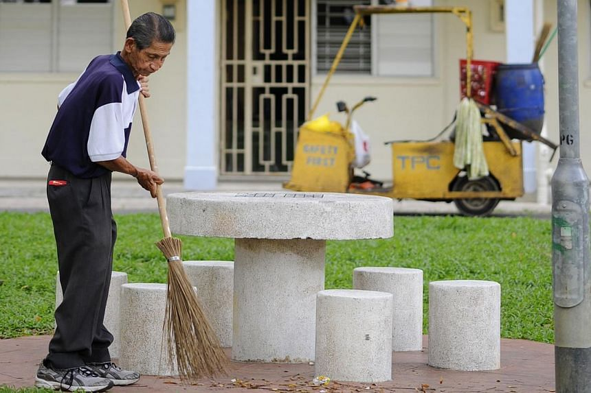 An elderly worker sweeping the common areas of a HDB two-room flat in Toa Payoh.Workers' Party MP Pritam Singh (Aljunied GRC) worries that higher CPF rates for older workers may cost them their jobs but People's Action Party MP David Ong (Juron