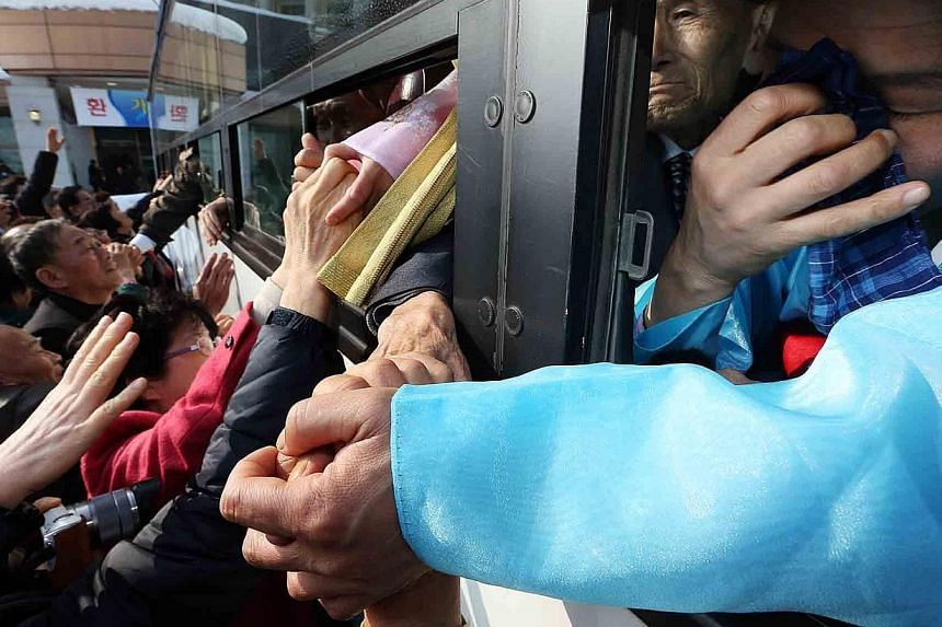 South Koreans bid farewell to their North Korean relatives from the window of a departing bus on the last day of family reuinons at the Mount Kumgang resort area of North Korea on Feb 25, 2014. South Korean President Park Geun Hye on Tuesday, Ma