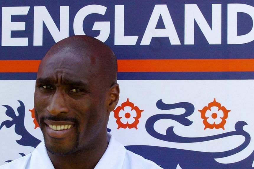 England's defender Sol Campbell poses for photographers after a press conference at the England media centre in Lisbon, Portugal, during the Euro 2004 championship on June 15, 2004. Two former England managers and one of the country's most famous bla