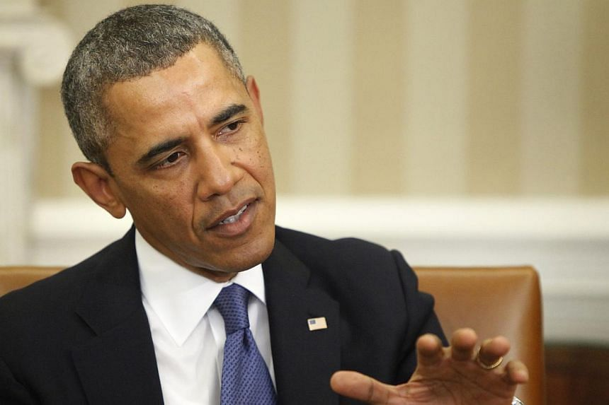 United States President Barack Obama comments to reporters on the situation in Ukraine before meeting with Israel's Prime Minister Benjamin Netanyahu in the Oval Office of the White House in Washington on March 3, 2014. -- PHOTO: REUTERS