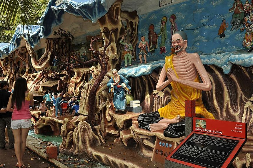 Free weekend tours of Haw Par Villa will be offered to Singaporeans on the 15th, 16th, 22nd and 23rd of this month, when the theme park's history will be explained to visitors. -- ST PHOTO: DESMOND WEE