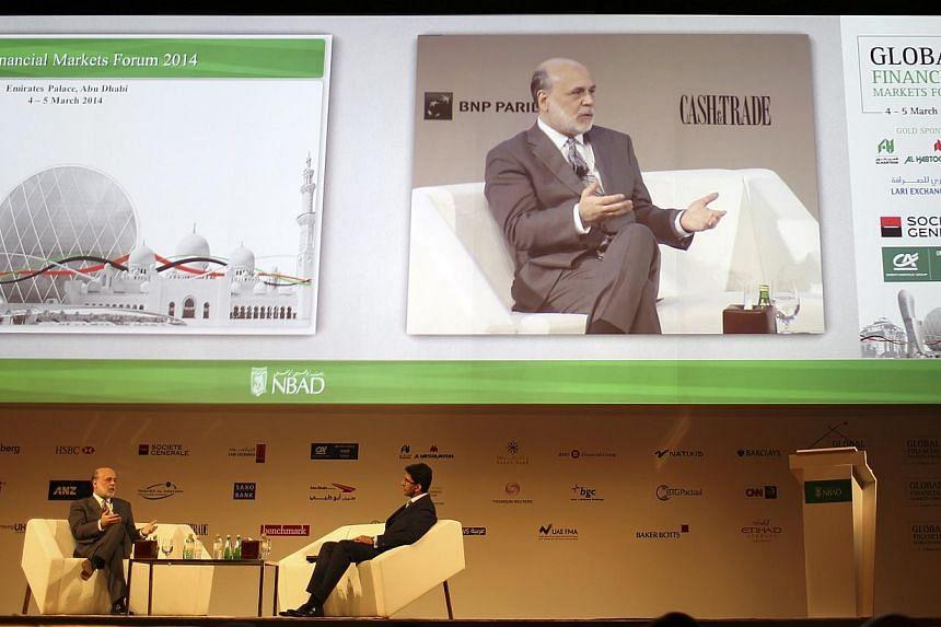 Former Federal Reserve Chairman Ben Bernanke (left) talks during Global Financial Markets Forum in Abu Dhabi on March 4, 2014. -- PHOTO: REUTERS