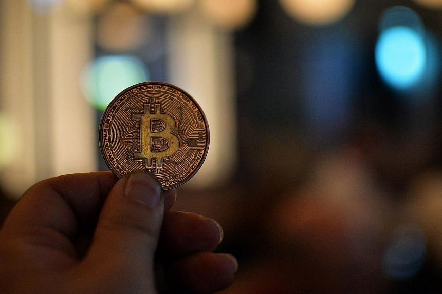 An alleged theft by hackers forced another online business serving bitcoin traders and investors to shut down on March 4, 2014. -- FILE PHOTO: AFP