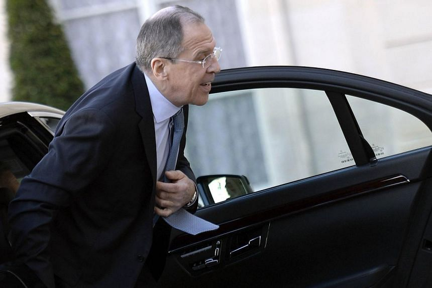 Russia's Foreign Minister Sergei Lavrov arrives at the Elysee presidential palace in Paris for a diplomatic meeting dedicated to the situation in Lebanon. Britain on Wednesday, March 4, 2014, urged Mr Lavrov to meet with his Ukrainian counterpart in