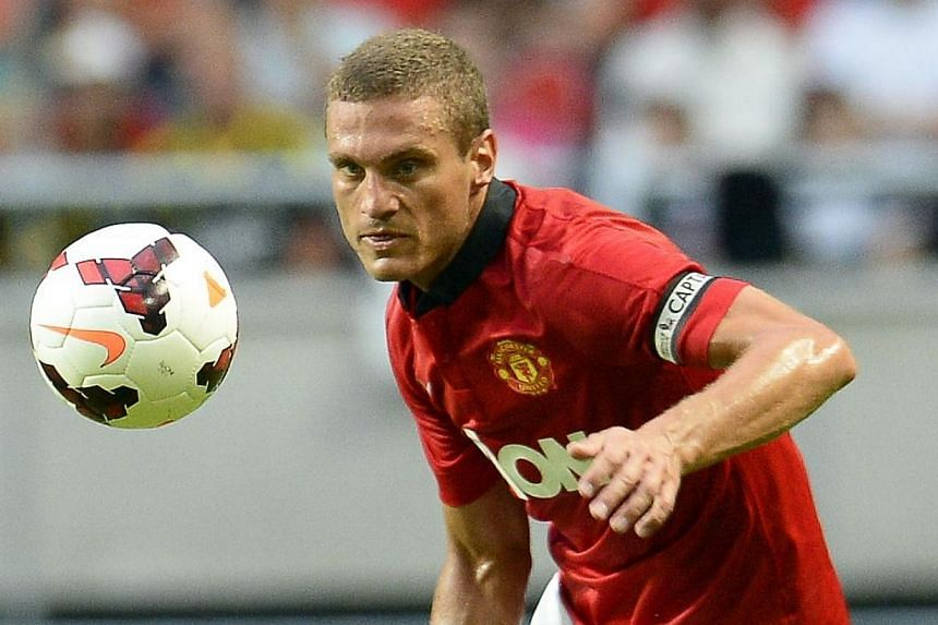 Manchester United captain Nemanja Vidic during a friendly match against AIK on Aug 6, 2013. Italian giants Inter Milan on Wednesday, March 4, 2014, confirmed that Vidic will join the club this summer. -- FILE PHOTO: AFP