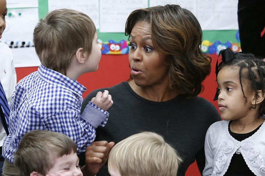United States First Lady Michelle Obama reacts as she meets pre-school students at the Washington Yu Ying Public Charter School ahead of her upcoming trip to China, in Washington March 4, 2014. -- PHOTO: REUTERS