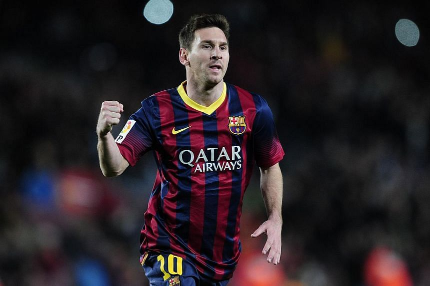 Barcelona's Argentinian forward Lionel Messi celebrates his goal during the Spanish league football match FC Barcelona vs UD Almeria at the Camp Nou stadium in Barcelona on March 2, 2014. -- PHOTO: AFP