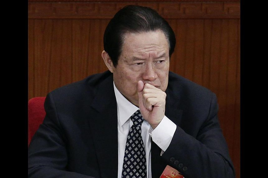 Former China Politburo Standing Committee Member Zhou Yongkang attends the second plenary meeting of the National People's Congress (NPC) at the Great Hall of the People in Beijing on March 8, 2012. Delegates at China's annual Parliament session