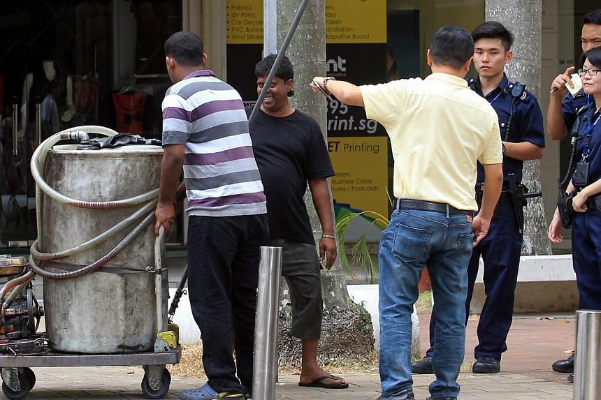 Three men came later to collect the equipment that had been left behind. -- PHOTO: LIANHE ZAOBAO