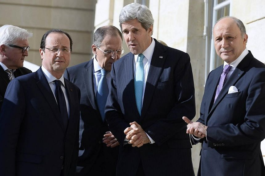 US Secretary of State John Kerry (second right), Russian Foreign Affairs Minister Sergei Lavrov (third from left), French President Francois Hollande (second from left), French Foreign Affairs Minister Laurent Fabius (right) and German Foreign Minist