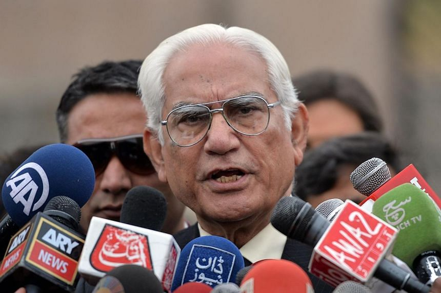 Pakistani lawyer for the country's former military ruler Pervez Musharraf, Ahmad Raza Kasuri, speaks to media outside a special court set up to try Musharraf after a hearing in Islamabad on Feb 21, 2014.Lawyers representing Pakistan's former mi