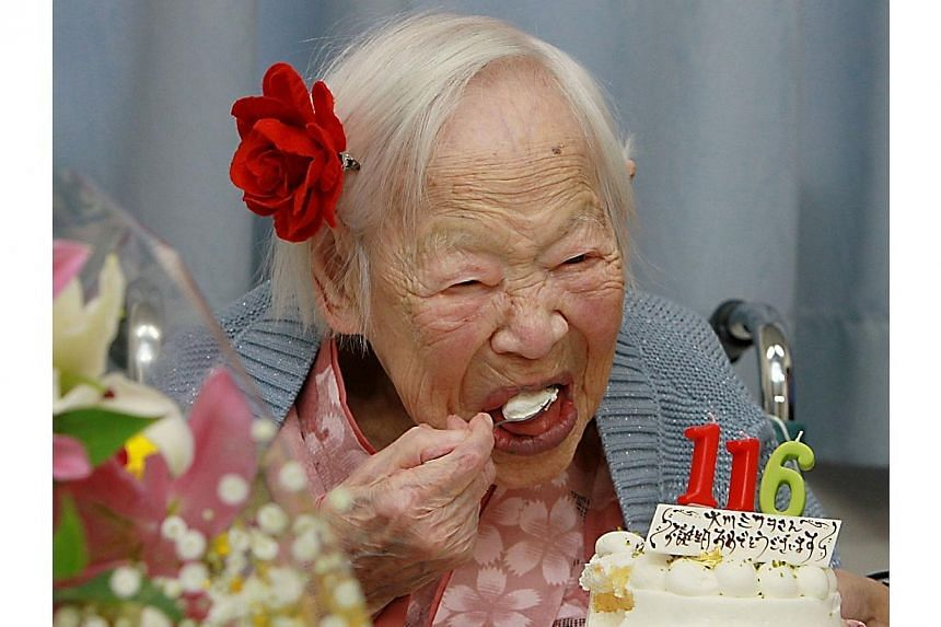 Misao Okawa, the world's oldest woman was celebrating her 116th birthday on Wednesday, March 5, 2014, in a Japanese nursing home with a cake and candles. -- PHOTO: AFP