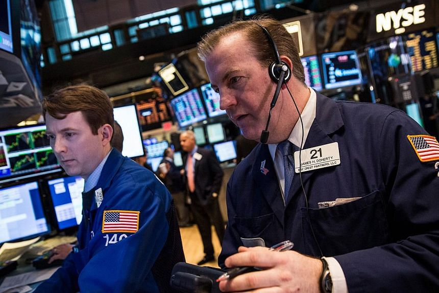 Traders work on the floor of the New York Stock Exchange on the morning of March 3, 2014 in New York City. US stocks soared on Tuesday and investors pushed the S&P 500 to its second record close in three days on signs of easing tensions over Ukra