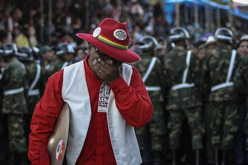 A musician from the Poopo Banda reacts after a footbridge collapsed during Carnival parade in Oruro, on March 1, 2014. Two musicians were killed and dozens injured, local media reported. -- FILE PHOTO: REUTERS