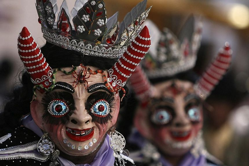 Members of the Diablada Autentica perform during the Carnival parade in Oruro, Bolivia, on March 1, 2014. -- FILE PHOTO: REUTERS