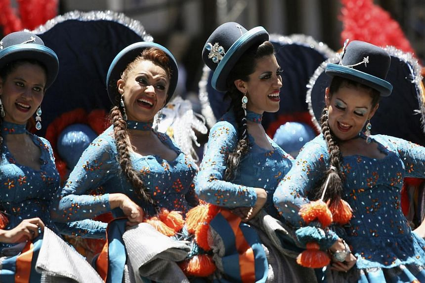 Members of the Morenenada Central perform during the Carnival parade in Oruro, Bolivia, on March 1, 2014. -- FILE PHOTO: REUTERS
