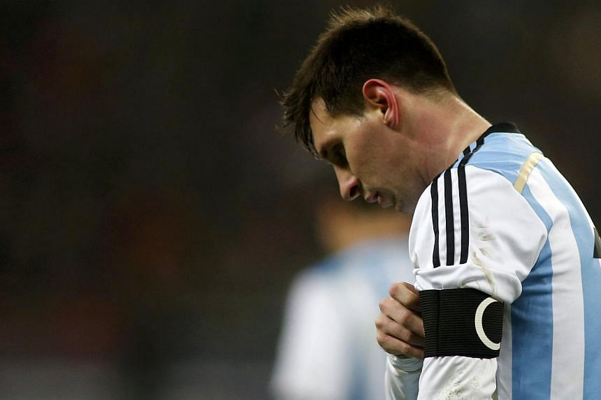 Argentina's Lionel Messi leaves the field at half time during their international friendly soccer match against Romania at the National Arena in Bucharest on March 5, 2014. -- PHOTO: REUTERS