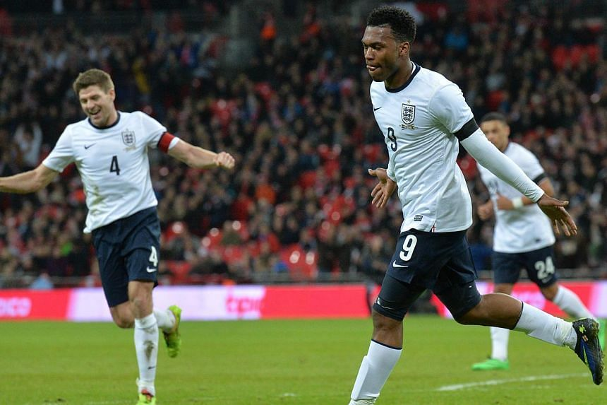 England striker Daniel Sturridge (right) celebrates scoring the opening goal during the international friendly football match between England and Denmark at Wembley Stadium in London on March 5, 2014. -- PHOTO: AFP