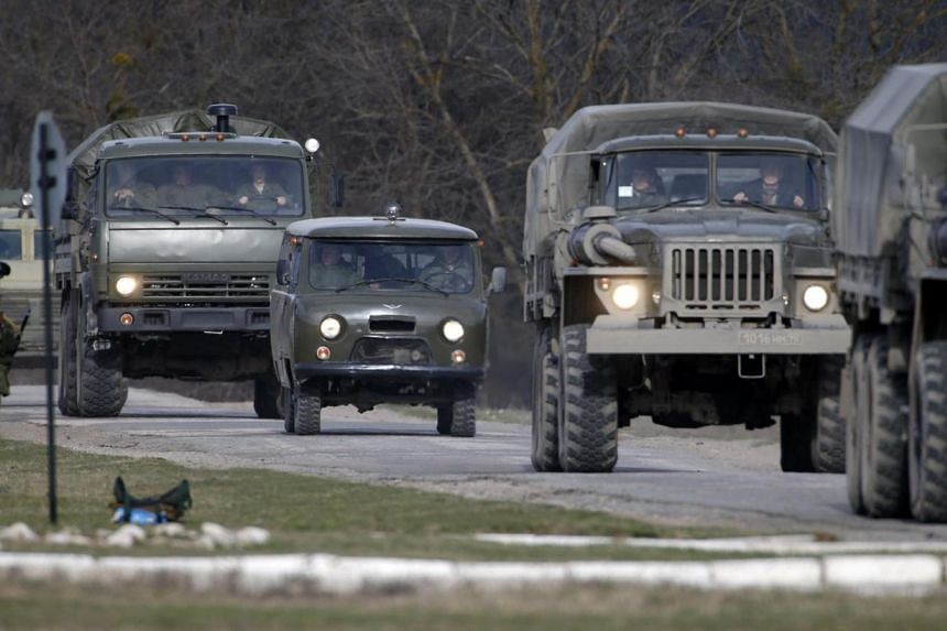 Military vehicles, believed to be the property of Russia, near a Ukrainian military base in the village of Perevalnoye, outside Simferopol, on March 6, 2014. Crimea's vice premier, Mr Rustam Temirgaliev, said on Thursday a referendum on the region's