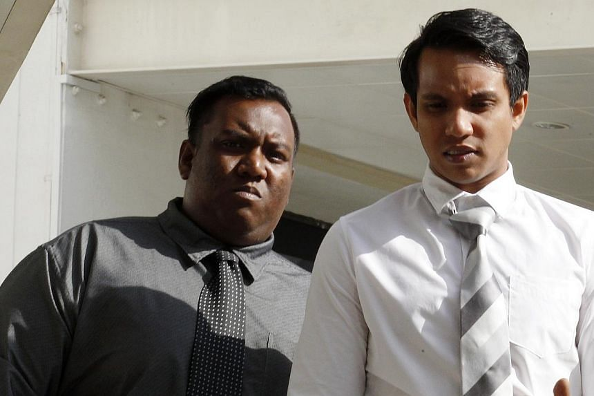 Two National Environmental Agency officers Muhammad Alhaffif Mohamad Saifuddin (left), 28, and Muhammad Ramadan Mohamad Saifuddin, 25, were charged in court on Thursday with tipping off two men on a surprise inspection in the Arab Street area. -- ST