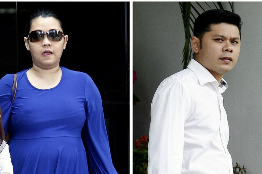 Couple Nuraini Hassan (left) andMohamad Al-Hafiz Nordin,who faced a total of nine charges of maid abuse, pleaded guilty on Thursday, March 6, 2014, to assaulting their domestic worker who was 20kg lighter by the time she escaped from her