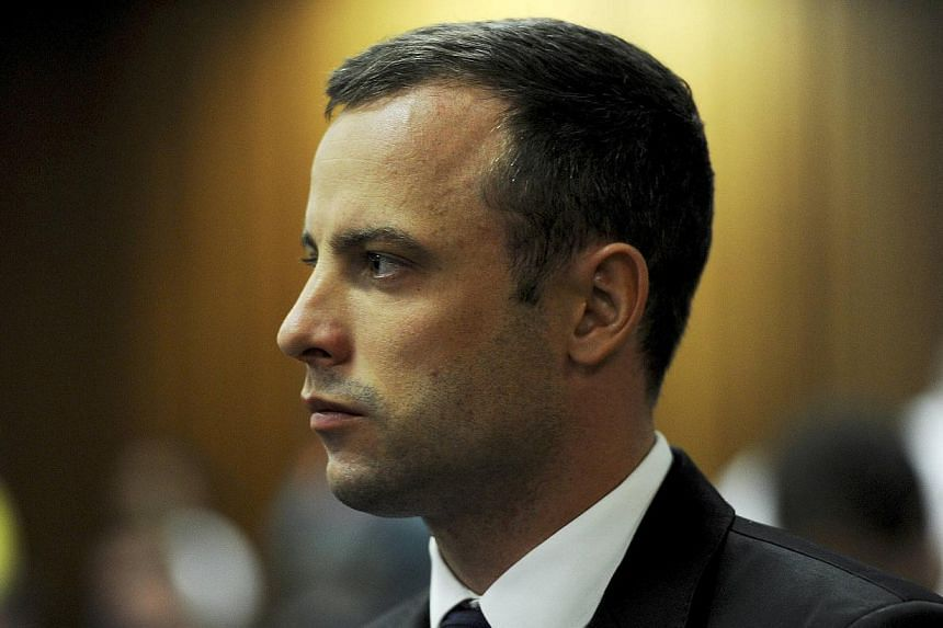 """Oscar Pistorius' defence lawyer accused a key witness of doctoring evidence with his wife to """"incriminate"""" the athlete on Thursday, March 6, 2014, as he tried to scupper the prosecution's principal line of attack. -- PHOTO: AFP"""