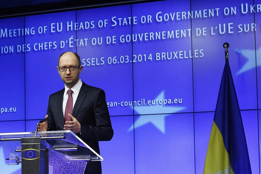 Ukraine's Prime Minister Arseniy Yatsenyuk holds a news conference during a European leaders emergency summit on Ukraine, in Brussels, on March 6, 2014. Ukraine is ready to sign as soon as possible the association pact with the EU, whose rejection by