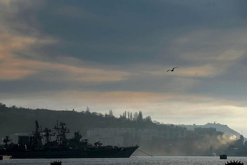 A view of the Russian navy frigate Pytlivyy docked in the port of Sevastopol, where a Ukrainian navy base is located, on March 6, 2014. European Union leaders meet for an emergency summit in Brussels on Thursday to discuss the crisis in Ukraine and h