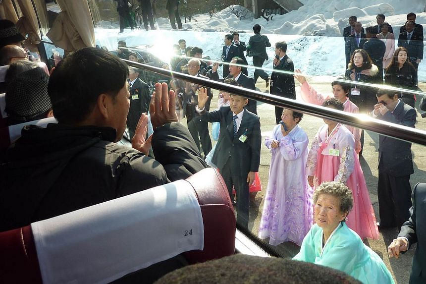 South Koreans aboard a bus wave goodbye to their North Korean relatives as they depart a family reunion event at the North Korean resort area of Mount Kumgang on Feb 22, 2014. -- FILE PHOTO: AFP