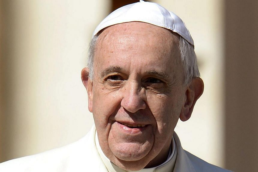 Pope Francis holds his weekly general audience at St Peter's Square in Vatican city on March 5, 2014. -- PHOTO: AFP