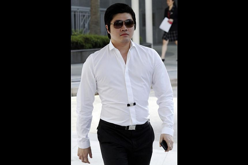 Alleged match-fixer Eric Ding Si Yang (pictured) has to give his defence in court, after a district court found on Thursday, March 6, 2014, that prosecutors had made out a prima facie case against him for corruption. -- ST PHOTO: WONG KWAI CHOW