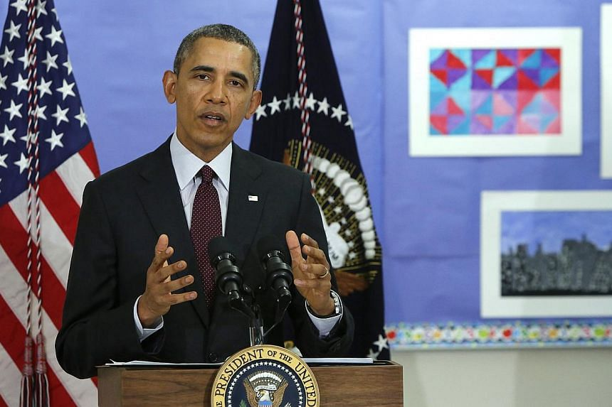 """US President Barack Obama answers a question about the situation in Ukraine at Powell Elementary School in Washington on March 4, 2014. MrObama on Thursday moved to impose visa bans """"in response to Russia's ongoing violation of Ukraine's sovere"""