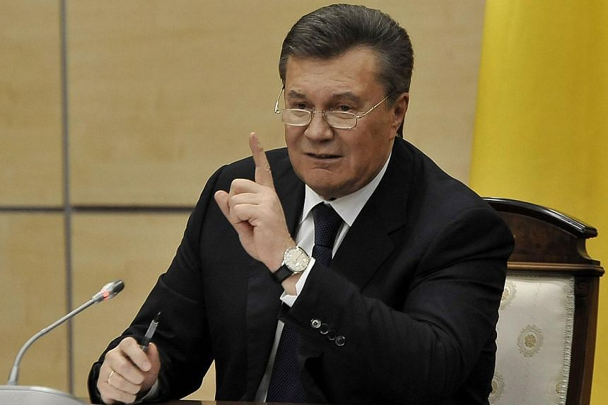 Deposed Ukrainian president Viktor Yanukovych gestures at a press conference in the southern Russian city of Rostov-on-Don, on Feb 28, 2014.The European Union on Thursday froze assets held in the 28-nation bloc by 18 Ukrainians accused of embez