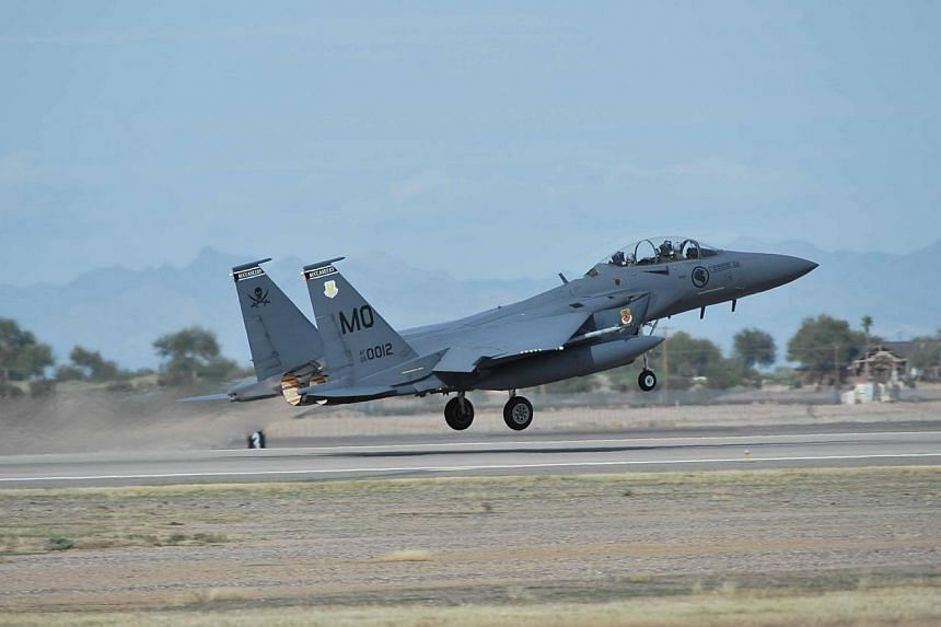 An RSAF F-15SG fighter aircraft taking off for a mission during XFS 2013. -- PHOTO: MINDEF