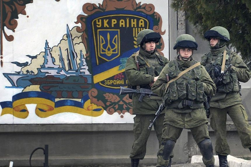 Russian forces block access to the base of the 36th detached brigade of the Ukrainian Navy's coastal guards, not far from the village of Perevalne, near Simferopol on Wednesday, March 5, 2014.The Organisation for Security and Co-operation in Eu