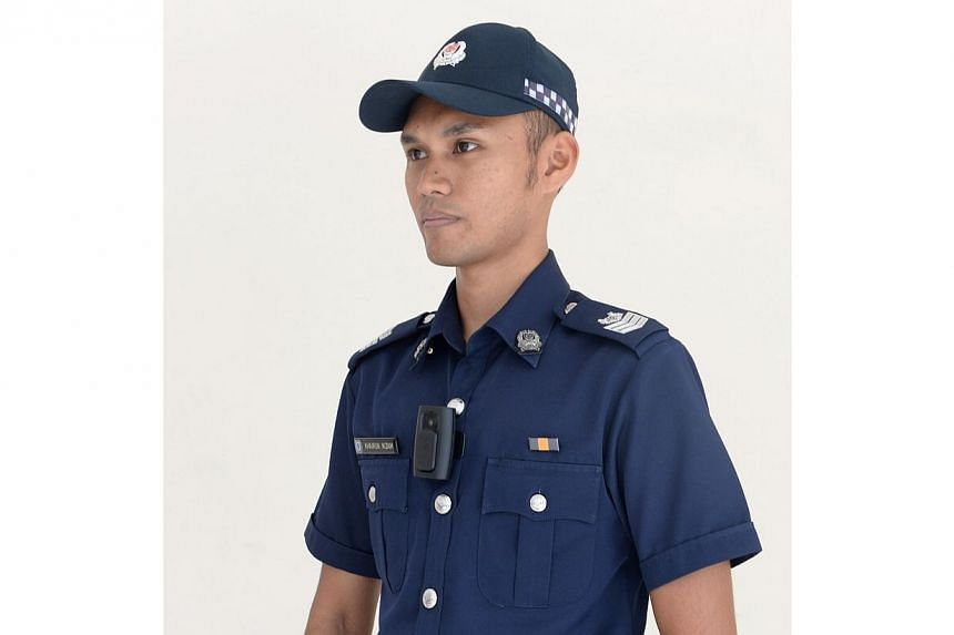 Police officers in Singapore will start wearing body-worn cameras in the middle of the year, in a pilot project that aims to boost frontline policing. -- ST PHOTO: AZIZ HUSSIN