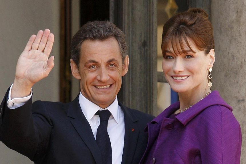 Mr Nicolas Sarkozy and his wife Carla Bruni on Thursday, March 6, 2014, launched legal action over the publication of potentially compromising tapes secretly recorded during his 2007-12 term as French president. -- FILE PHOTO: REUTERS