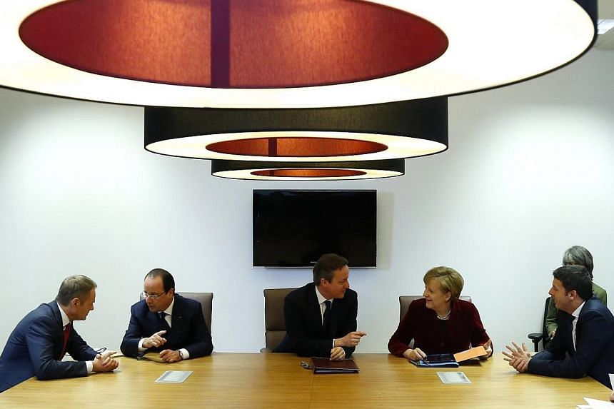 (From left) Poland's Prime Minister Donald Tusk, France's President Francois Hollande, Britain's Prime Minister David Cameron, Germany's Chancellor Angela Merkel and Italy's Prime Minister Matteo Renzi meet ahead of a European leaders emergency summi