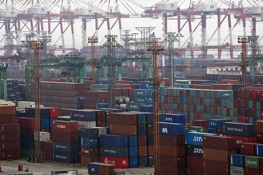 Containers are seen at a port of Shanghai Free Trade Zone  on Feb 11, 2014. CHINA is fully confident of reaching its target of 7.5 per cent growth in total trade this year, as its exports get a boost from the improving global economic outlook an