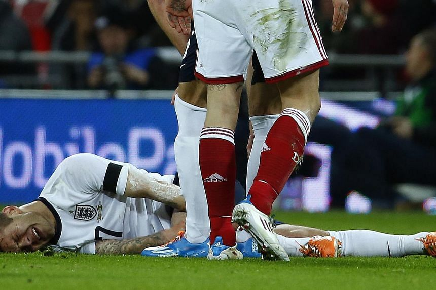 England's Jack Wilshere reacts after being fouled by Denmark's Daniel Agger (unseen) during their international friendly soccer match at Wembley Stadium in London on March 5, 2014. -- FILE PHOTO: REUTERS
