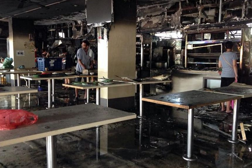 Aftermath of the fire at Marine Terrace coffee shop. -- ST PHOTO: JAMIE KOH